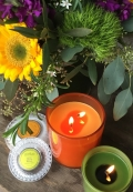 Mango Tangerine and Arugula Archipelago Candles with flowers