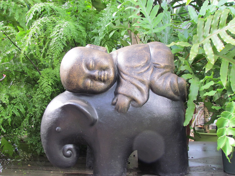 Baby Buddha riding an elephant