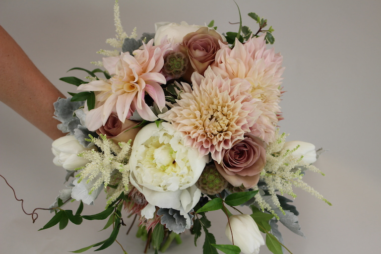 Bridal bouquet with peach dahlia and astilbe