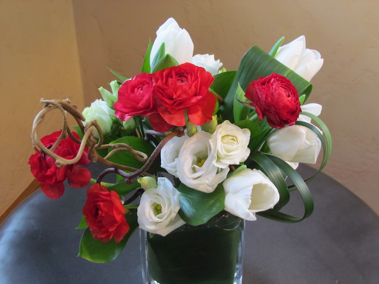 Ranunculus with white tulips and lisianthus  $55 to $75