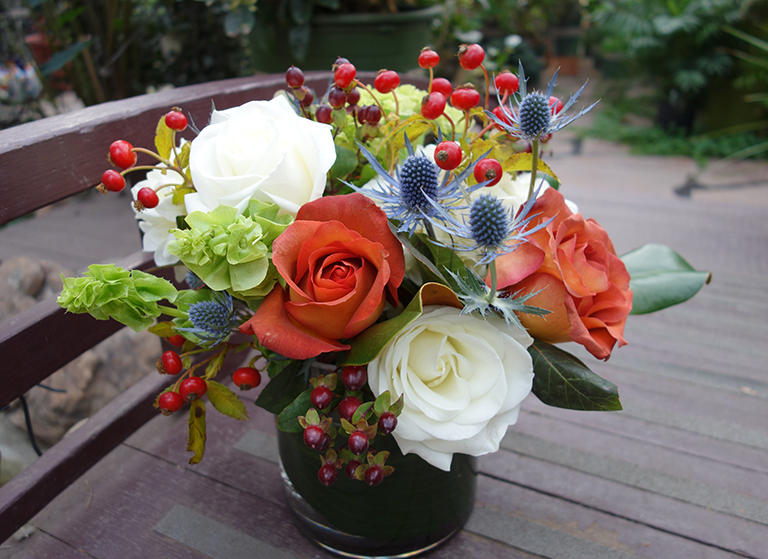 Roses, Alpine Thistle, Bells of Ireland and Rose Hips