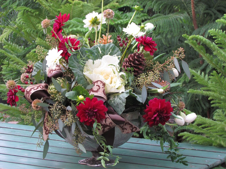 Flowering kale with red dahlias and gold pinecones