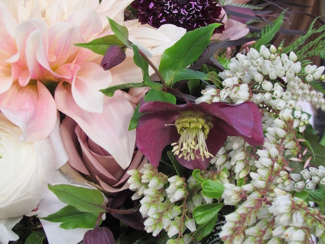 An open mauve Lenten Rose blossom accents this bridal bouquet