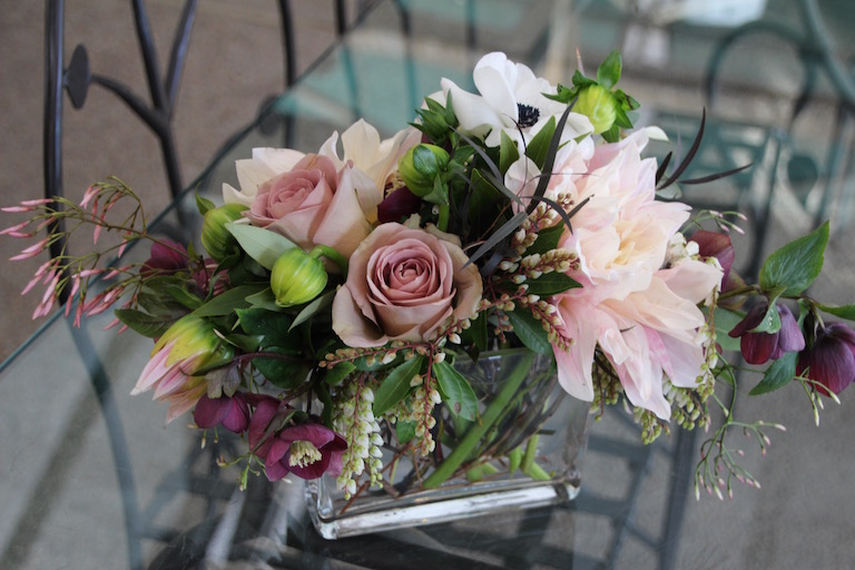 Centerpieces for the wedding table with magenta hellebores