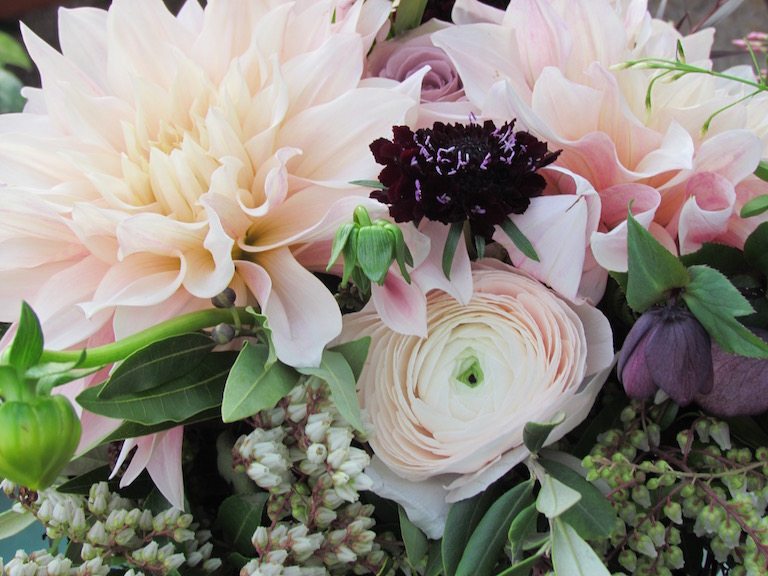 Bouquet with magenta scabiosa and peach ranunculus