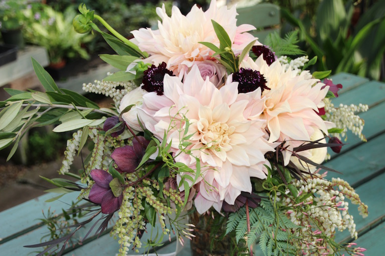 Bridal bouquet with peach dahlias, magenta scabies, antique roses and hellebores