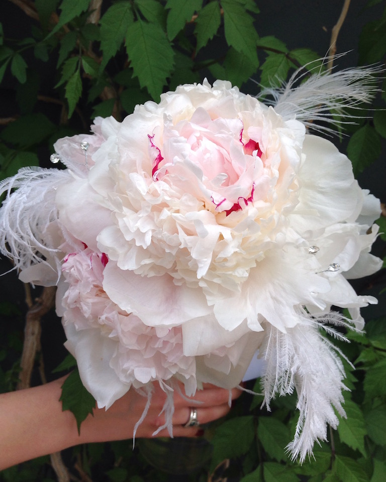 Peonies and white ostrich feathers for a bridesmaid