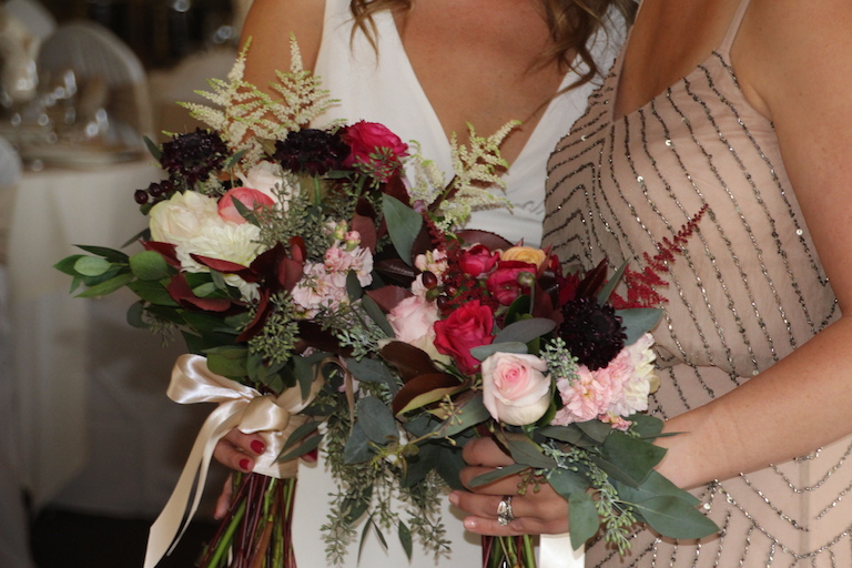 Bride and bridesmaid bouquets at Boulder Country Club