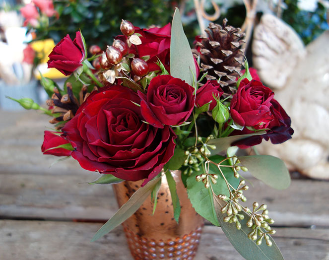 Red roses in a copper pot