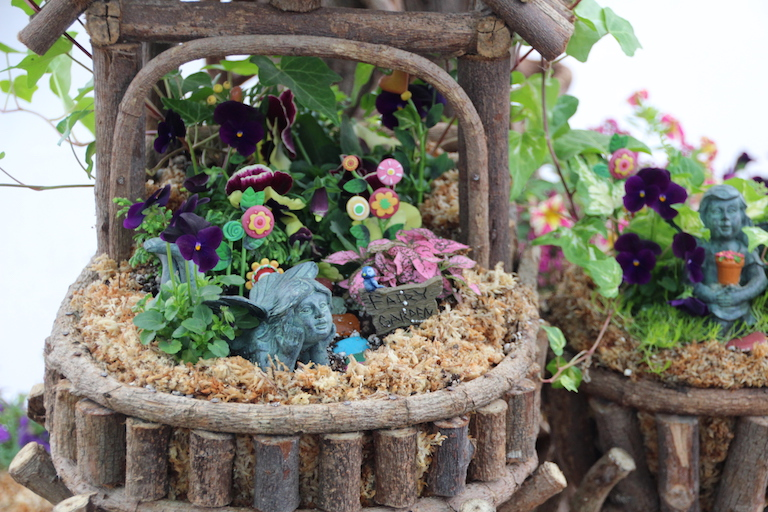 Outdoor fairy garden in a river root planter
