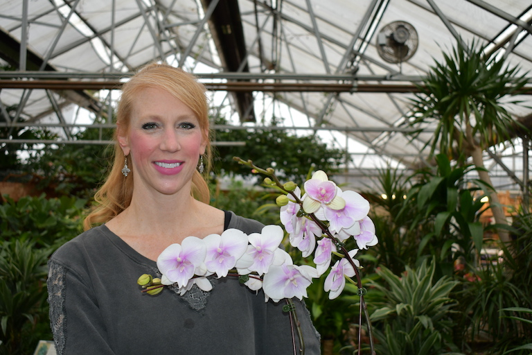 Mandy with a beautiful orchid plant