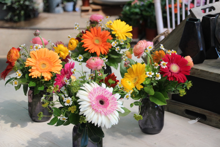 Wedding bud vases featuring gerberas