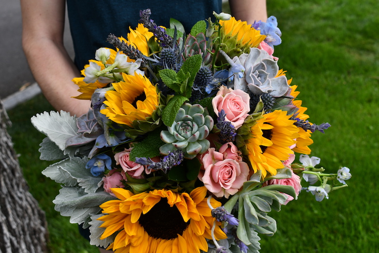 Sunflowers, succulents, dusty miller and mint in a bridal bouquet