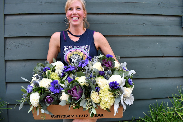 Mandy gets ready to deliver a box of wedding centerpieces