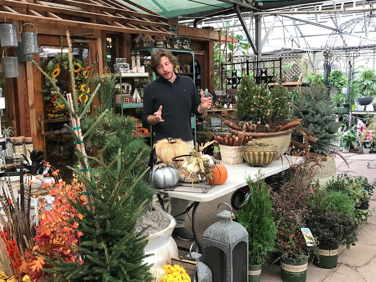Jason teaching fall containers with evergreens