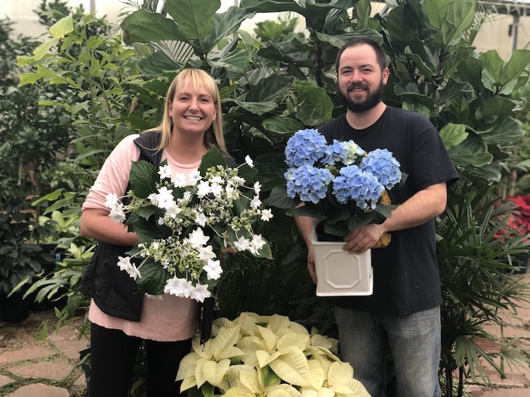 Trevor and Jenn with blooming plants for the holidays