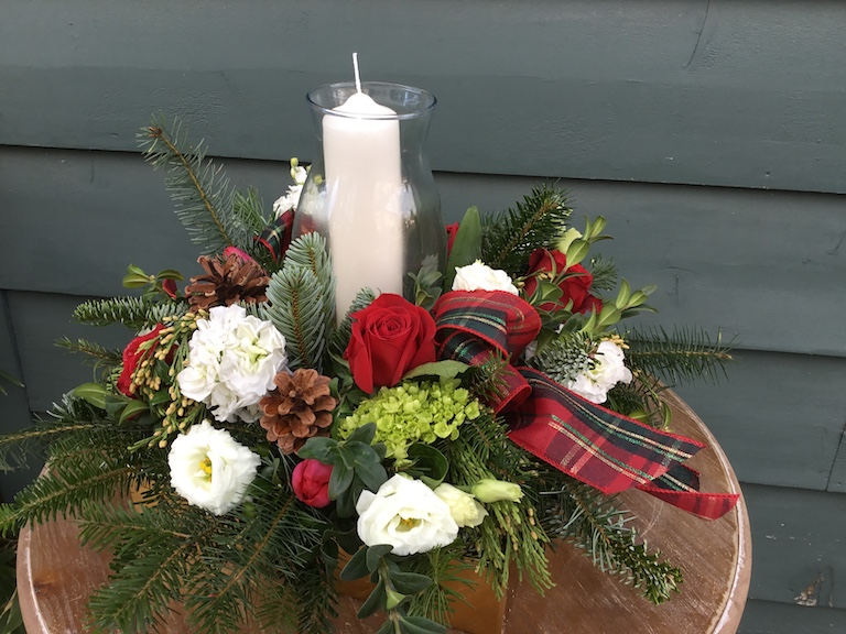 Hurricane candle with red roses for the holidays