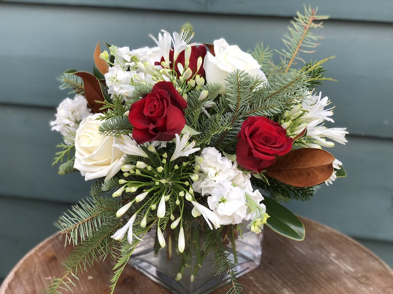 Christmas flowers with red roses and white agapanthus