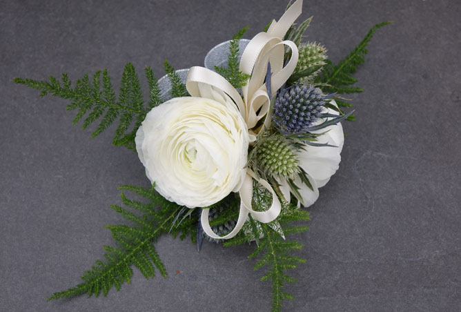 Ranunculus and Alpine Thistle Corsage Sturtz and Copeland