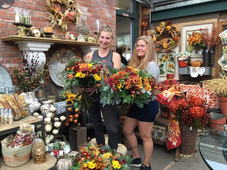Steph and Bernadette with an assortment of Thanksgiving Mums