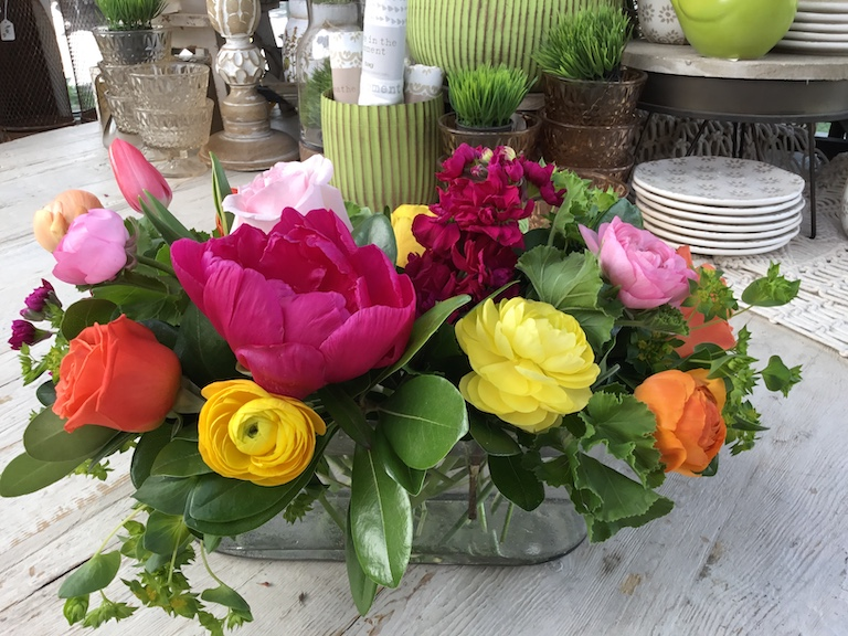 Yellow ranunculus, roses, peonies and fragrant stock